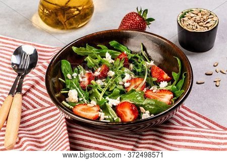 Salad Rocket With Fresh Strawberries And Ricotta Cheese. Delicious Breakfast Or Snack On A Light Bac