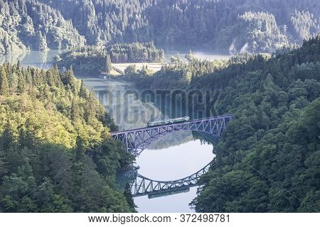 Fukushima, Japan - June 17 : The Local Train Tadami Line And Tadami River On June 17 , 2017 In Fukus