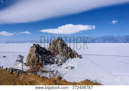 Cape Burhan On Shamanka Rock In Olkhon Island In Sunny March Day. Lake Baikal With Beautiful Clouds