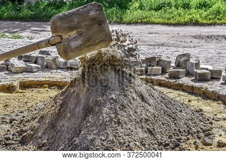 Preparation Of A Dry Cement-sand Mixture For The Repair Of Stone Paving Slabs, Garden Paths, Courtya