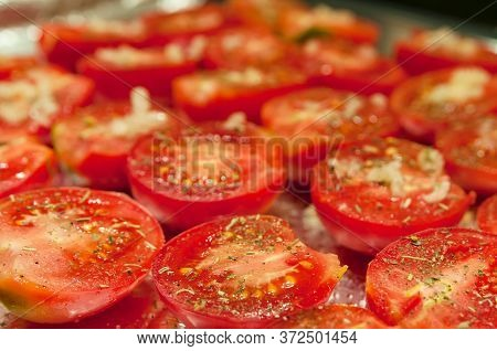 Red Halves Juicy Tomatoes With On A Baking Sheet Before Drying.
