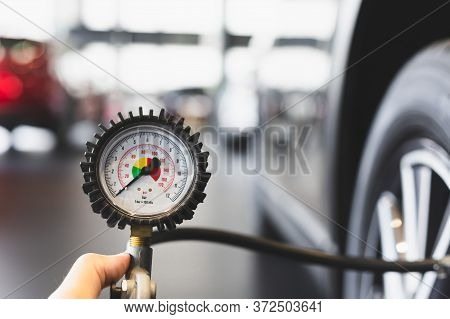 Inspection Measure Quantity Inflated Rubber Tires Car Close Up Hand Holding Machine Inflated Pressur