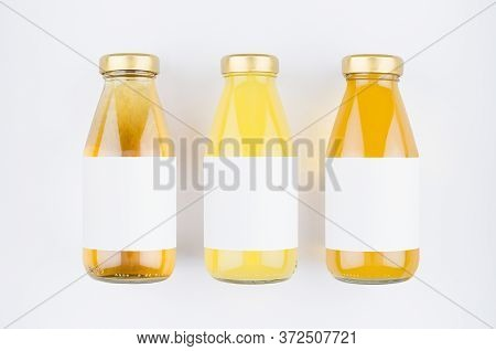 Collection Of Fresh Fruits Juices - Yellow, Orange Muddy And Transparent In Glass Bottles With Blank