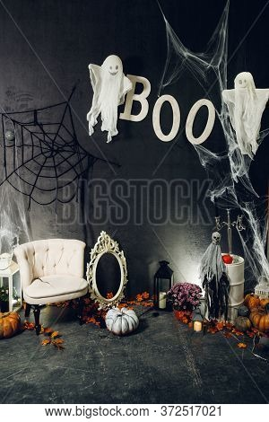 Close Up Photozone With Pumpkins, Candles, Scary Ghost And Cobweb For Halloween Party
