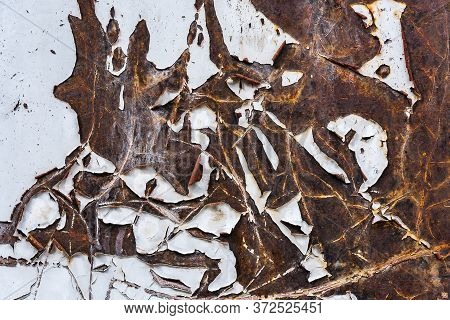 The Texture Of A Rusty Sheet Of Iron With Peeled Paint Close Up