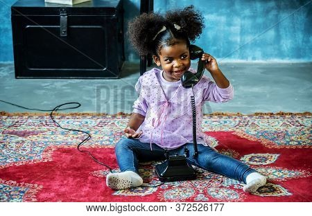 Cute Little African American Girl Playing With Vintage Old Dial Phone On The Carpet, Bonding Time, E