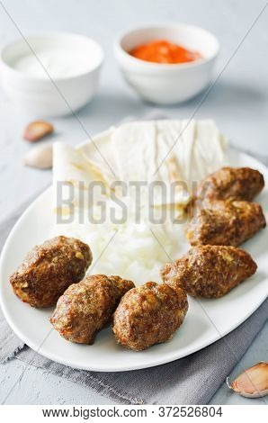 Minced Meat Sausage With Onion, Sour Cream, Pita And Red Bell Pepper Relish
