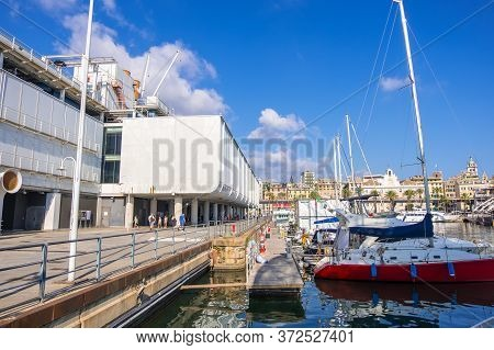 Genoa, Italy - August 18, 2019: Genoa Aquarium, Largest In Italy And Yachts Moored In Porto Antico D