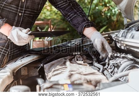 Car Maintenance. Men At Work From Home. Auto Mechanic Repair Engine. Social Distancing And New Norma