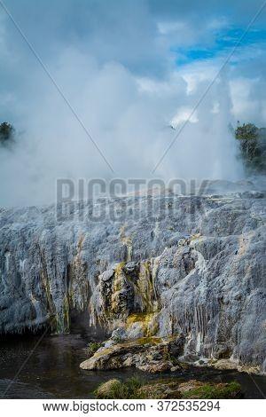 Steaming Geysers Erupting Above Sulphur Covered Rocks