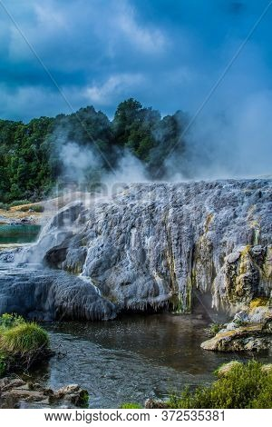 Active Geysers Erupting Above Sulphur Covered Rocks