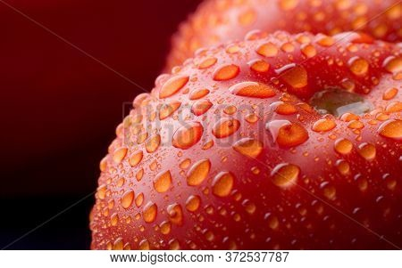 Water Drops On Red Coloured Apple In Close-up