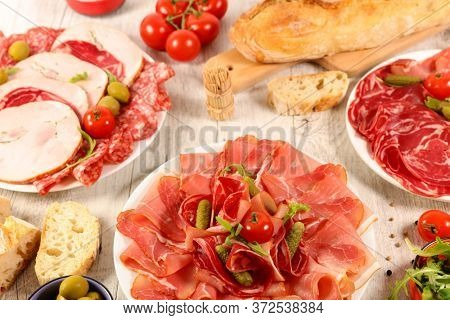 assorted of delicatessen, salami, bacon, ham with baguette