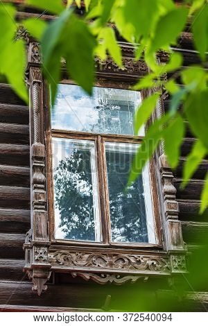 Wooden Window With Carved Platbands Of A Traditional Siberian House