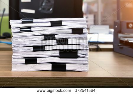 Close-up Pile Of A Lots Paper And Paperwork Report Or Printout Document On Office Desk Stack Up For