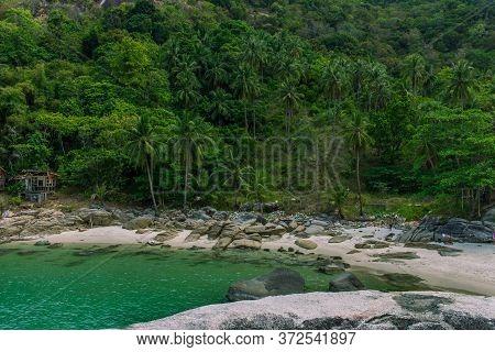 Koh Phangan, Thailand- April 19 2019: Island White Sand Nudist Beach, Jungle Background