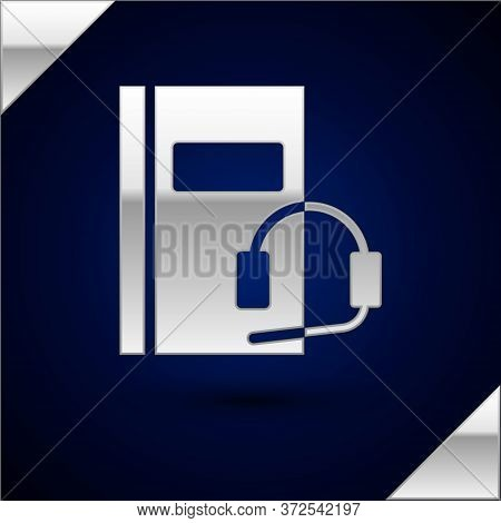 Silver Audio Book Icon Isolated On Dark Blue Background. Book With Headphones. Audio Guide Sign. Onl