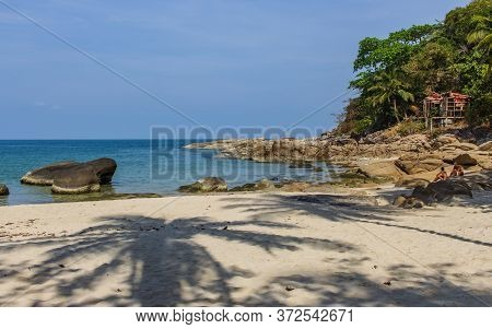 Koh Phangan, Thailand- April 19 2019: Island White Sand Nudist Beach, Palm Tree Shadow