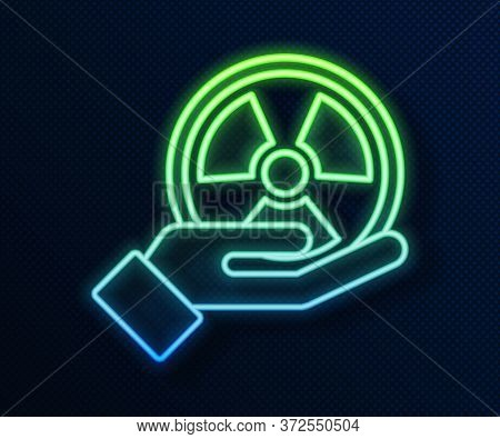 Glowing Neon Line Radioactive In Hand Icon Isolated On Blue Background. Radioactive Toxic Symbol. Ra