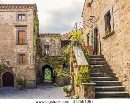 Idyllic Inner Alley Of Civita Di Bagnoregio, Ghost Mediaeval Town Built Above A Plateau Of Friable V