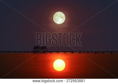 Reflection Of Sunset  Silhouette Bridge And Pavillion In Sea And Full Moon On The Sky