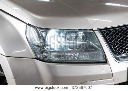 Novosibirsk/ Russia - April 28 2020: Suzuki Grand Vitara, Beige Car Headlights. Exterior Detail. Clo