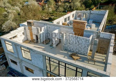 Building Site Of A House Under Construction Made From White Foam Concrete Blocks. Building New Frame