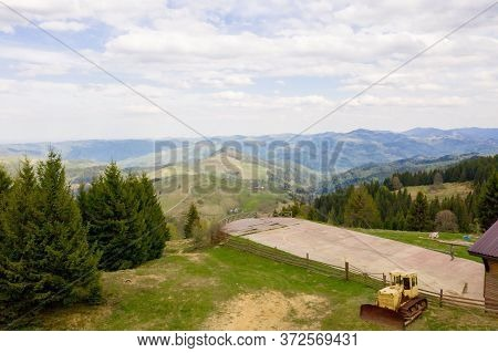 Take-off And Landing Pad For Rescue Helicopters In The Green Mountains. A Helicopter Landing Sign At