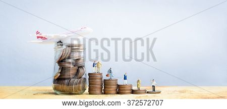 Miniature People Standing On Stack Of Coins. Inequality And Social Class. Income And Economic Inequa