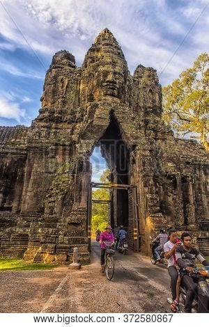 Siem Reap, Cambodia 29.06.2017  Gate To Angkor Thom Lined By Row Of Giant Figures Demons, Angkor, Ca