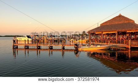 Small Pier On The Florida Keys In The Evening Sun- Islamorada, Florida - April 12, 2016