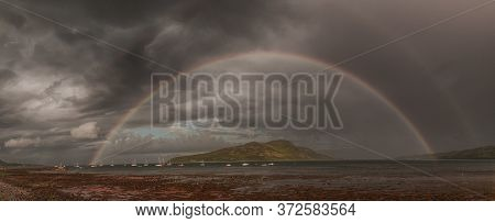 A Rainbow Panoramic Shot From Lamlash Beach On The Isle Of Arran Looking Out Over Holy Isle In The B