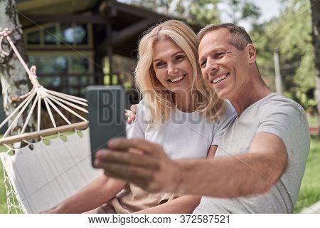 Merry Spouses Taking Selfie In Green Yard