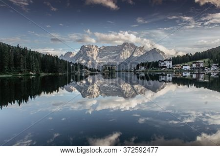 Reflections on the Lake Misurina situated in 1,754 m above sea level. It is one of the most beautiful mountain lakes in the Dolomites,Italy.Scenic view of lake and mountains.Copy space website banner