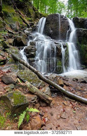 Rocks In Waterfall Stream. Beautiful Nature Scenery In Forest. Cascade Of Rapid Mountain River. Lush