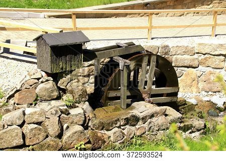Small Mill Wheel In A Watercourse In The Sunshine