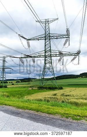 Electricity Distribution - Czech Republic. Cloudy Sky. High-voltage Electric Pole,high Voltage Power
