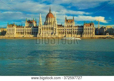Great Excursion And Travel Place In Budapest With Famous Parliament Building. Sightseeing Boat On Da