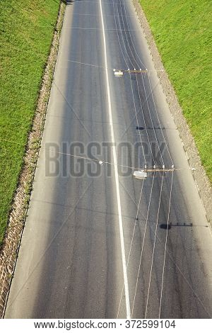 Motorway In A City. Empty Road Without Cars. Trolley Wire.