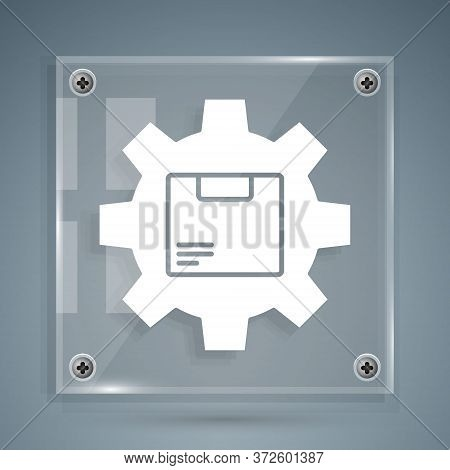 White Gear Wheel With Package Box Icon Isolated On Grey Background. Box, Package, Parcel Sign. Deliv