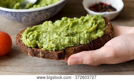 Rye Bread Toast With Mashed Avocado. Healthy Vegan Vegetarian Breakfast Or Snack Food. Avocado Toast