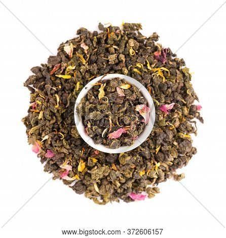 Tie Guan Yin Tea With The Petals Of Lilac, Hibiscus And Sunflowe, Isolated On White Background. Orga