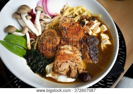 Delicious Chashu Ramen With Pork, Egg, Seaweed, Noodles And Mushrooms