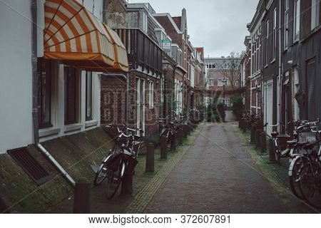 Haarlem, Netherlands - March 6, 2020: Empty Narrow Street With Residential Houses In Haarlem City Ce