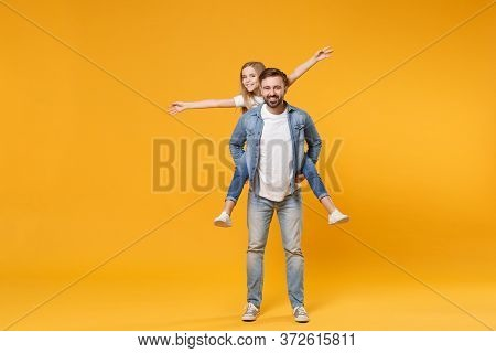 Funny Bearded Man With Child Baby Girl. Father Little Kid Daughter Isolated On Yellow Background. Lo