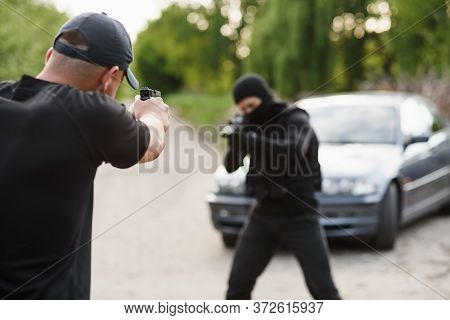 Shootout Between A Police Officer And A Offender. Stop Terrorism And Crime. The Police Officer And T