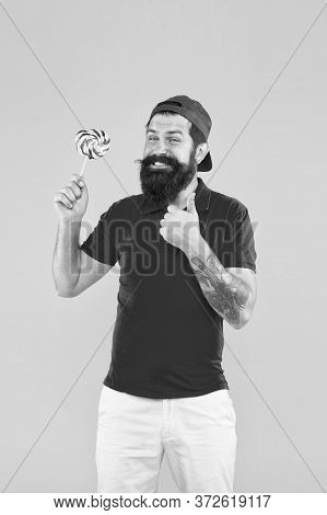 Just Excellent. Man With Lollipop And Smile. Brutal Bearded Man In Uniform. Care About Healthy Smile