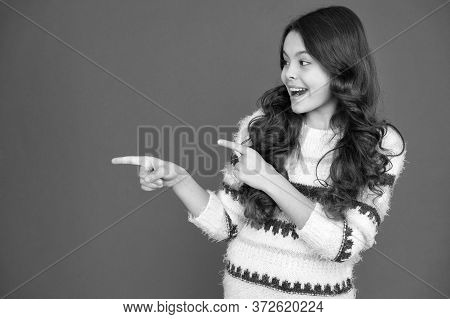 Publicity Stunt. Happy Kid Pointing At Red Background. Little Child With Pointing Gesture. Index Fin