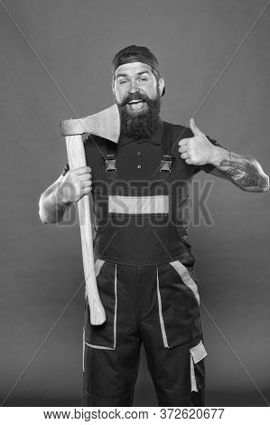 Shaving Salon. Handsome Happy Man With Axe. Making His Beard Shape. Agriculture And Forestry Theme.