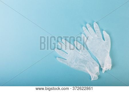 Whitte Surgical Gloves Isolated On The Blue Background. Concept Protect Against Infection Or Contami